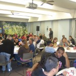 Guests and volunteers enjoy the meal.