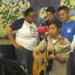 Volunteers lead Christmas carols.