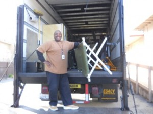 Lead Overnight Supervisor Ron Eiland unloads cots from a truck.