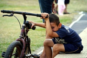 Hogar-Cristiano-orphanage-boy-with-bike-Matthew-Borror