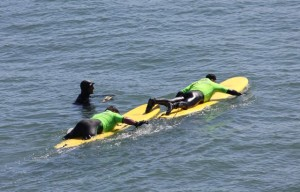 Operation-Surf-wounded-soldier-gets-tow-on-surfboard-by-Pam-Marino-Good-Neighbor-Stories