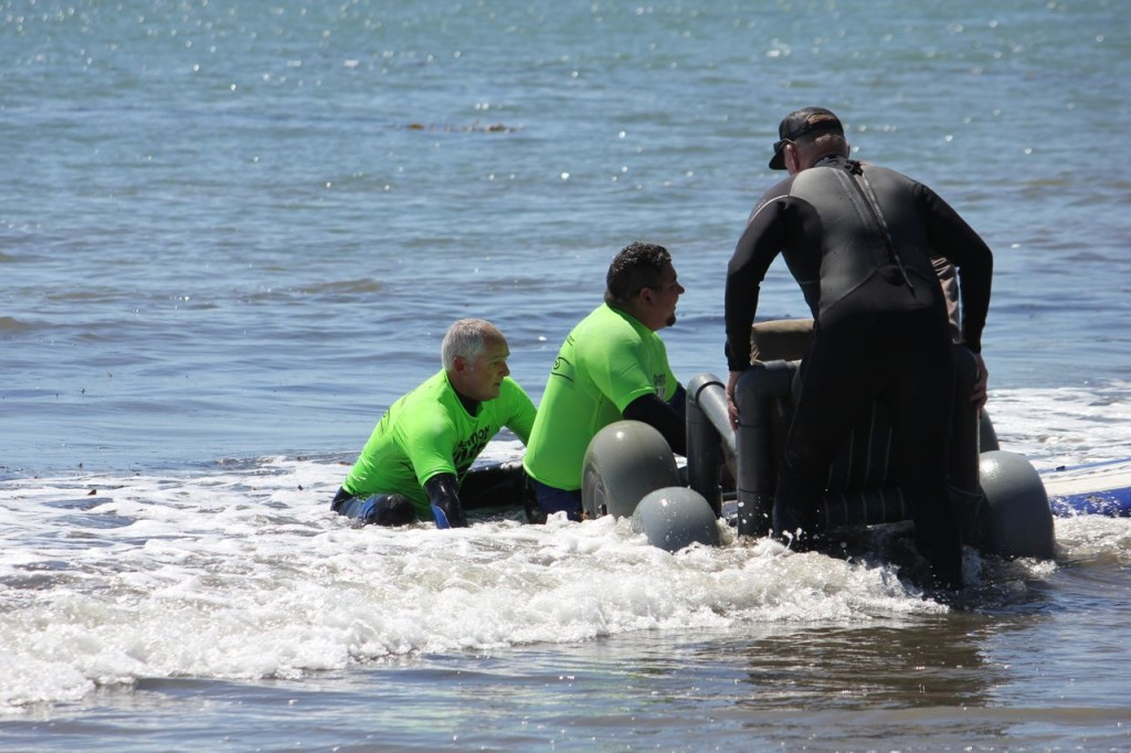 Volunteers Help Soldier Into Wheelchair