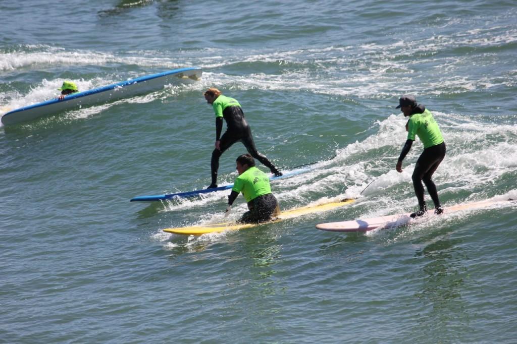 Volunteers Surfing Alongside Soldier