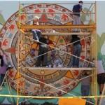 Volunteers paint a mural depicting an Aztec calendar at Biebrach Park in the Gardener Neighborhood of San Jose.