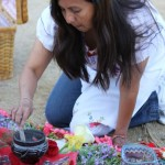 Patricia Palomares-Mason prepares for an Aztec blessing ceremony.
