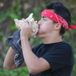 "Teoxiuh, ""Precious Rock,"" also known as Jacob Palomares-Mason, blows a conch during the ceremony."